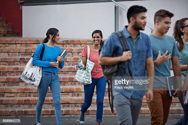 students walking out of school building & laughing - community college stock pictures, royalty-free photos & images