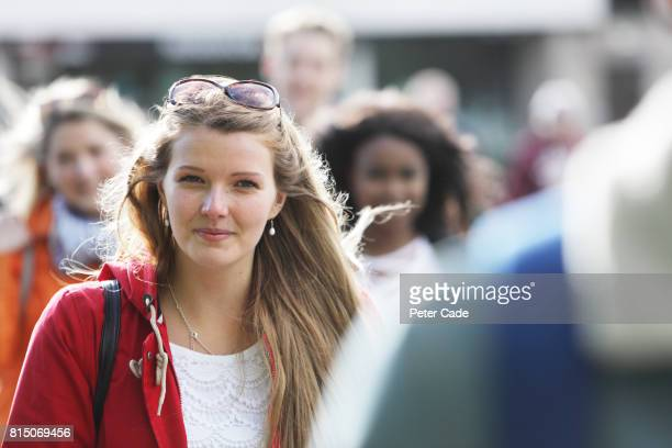 students walking outside university - image focus technique stock pictures, royalty-free photos & images