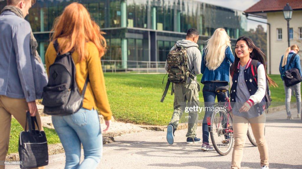 Students walking through the park : Stock Photo