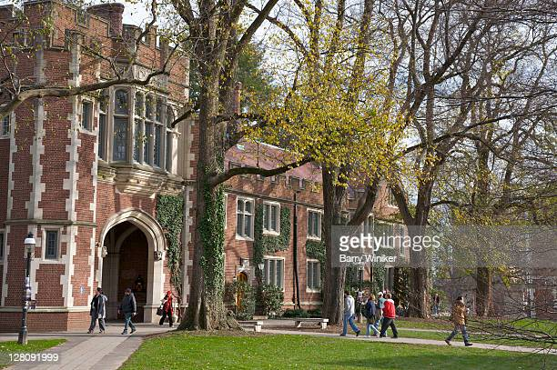 students walking to classes near building in the collegiate gothic style, princeton university, princeton, nj, usa - ivy league university stock pictures, royalty-free photos & images