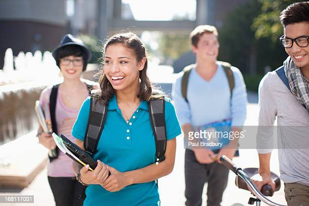 students walking together outdoors - middelbare scholier stockfoto's en -beelden