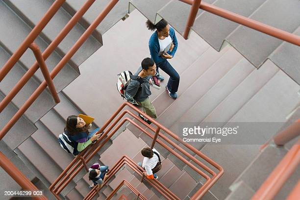 students walking up staircase, elevated view - education stock pictures, royalty-free photos & images