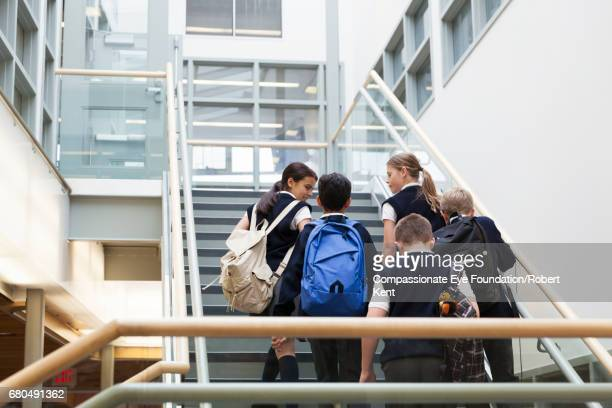 students walking up stairs - school uniform stock pictures, royalty-free photos & images