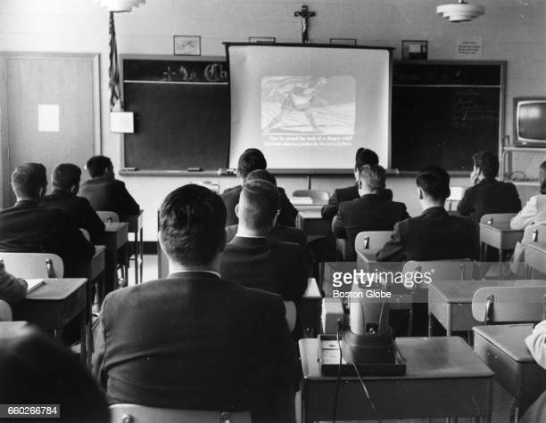 Students watch a slide lecture at Bishop Fenwick High School in Peabody MA on Sep 24 1964