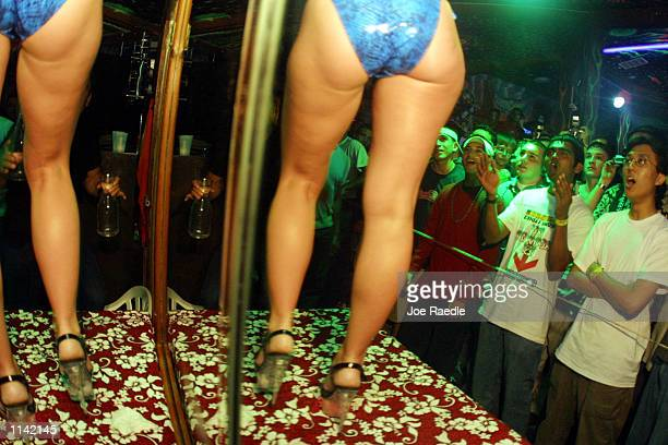 Students watch a wet tshirt contest at the Island Rave club at South Padre Island Texas March 18 2001 during the annual rite of Spring Break Some...
