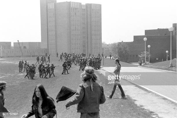 Students watch as Ohio National Guard troops march on campus during an antiwar demonstration at Kent State University Kent Ohio May 4 1970 Four...