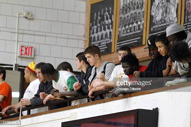 Students watch Harrison Barnes the nation's toprated high school basketball recruit at the first day of practice at Ames High School in Ames Iowa...