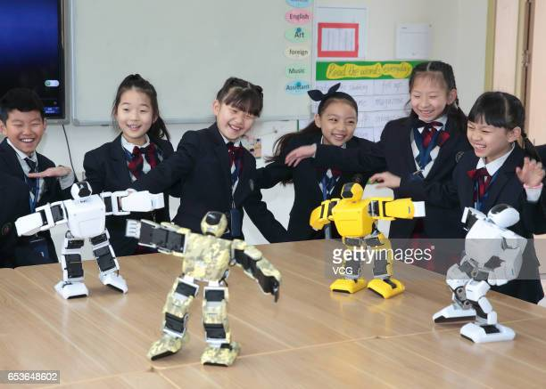 Students watch robots performing in the class at Hailiang Foreign Language School in Zhuji on March 15 2017 in Shaoxing Zhejiang Province of China...
