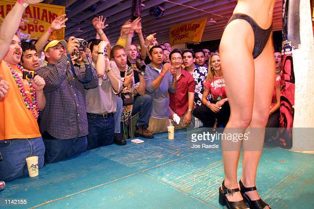 Students watch the 'best body' contest at Louie's Backyard in South Padre Island Texas March 18 2001 during the annual rite of Spring Break Some...