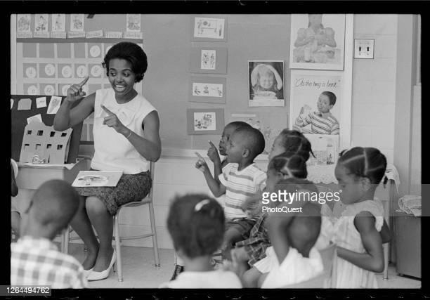 Students watch their teacher in an Operation Head Start class at Webb School, Washington DC, July 14, 1965.