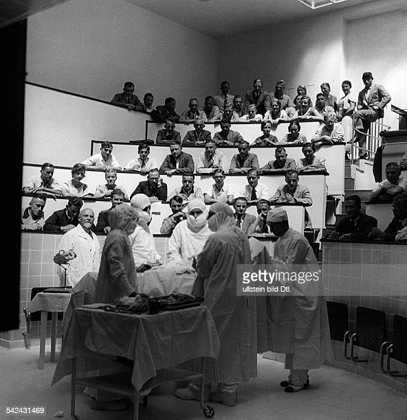 Students watching an operation in the operating room of a gynaecological hospital in Marburg Germany 1930ies