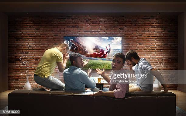 students watching baseball game at home - man cave stock photos and pictures