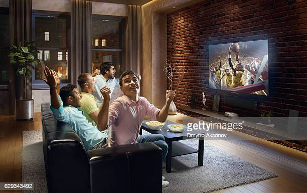 Students watching Basketball game at home