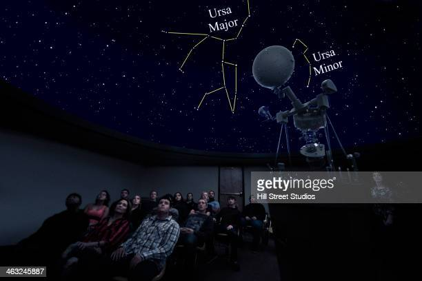 students watching constellations in planetarium - grande carro costellazione foto e immagini stock