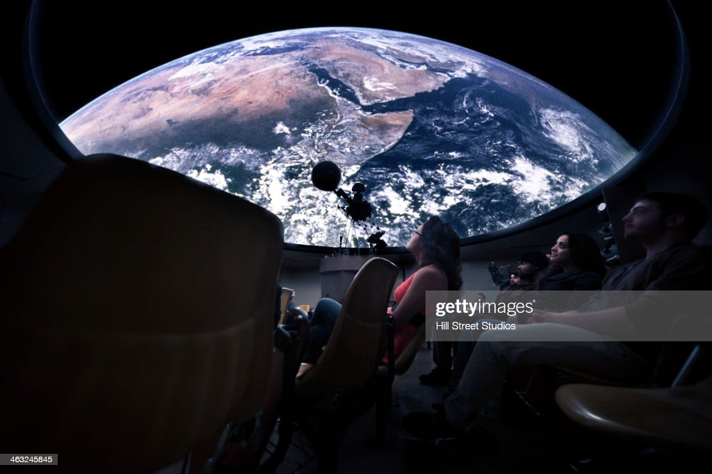 Students watching Earth in planetarium : Stock-Foto