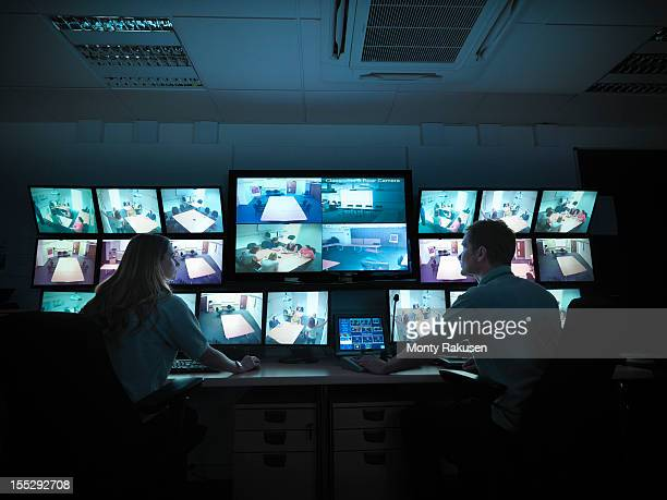 students watching screens in forensics training facility - woman prison stock-fotos und bilder