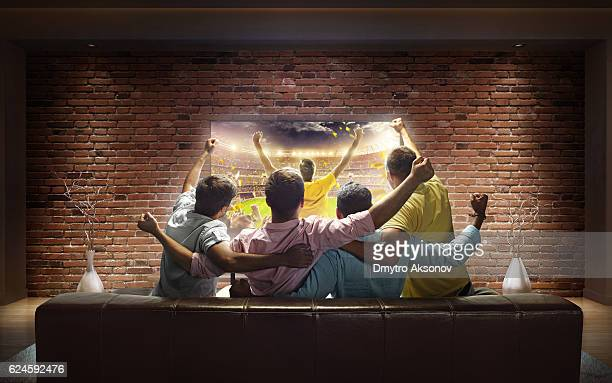 Students watching Sport game at home