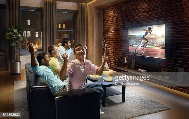 Students watching track and field event at home