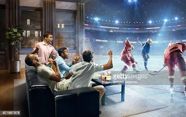 students watching very realistic ice hockey game at home - hóquei - fotografias e filmes do acervo
