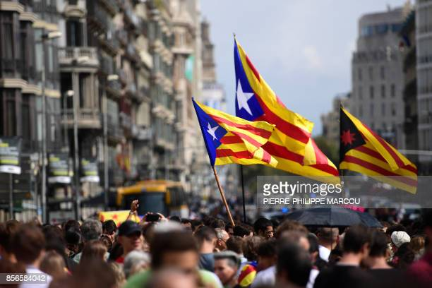 Students wave Catalan proindependence 'Estelada' flags during a protest in Barcelona on October 2 2017 a day after hundreds were injured in a police...