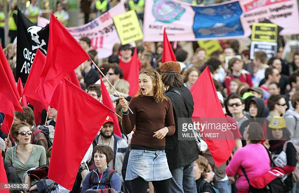 Students wave flags as they take to the streets of Melbourne in protest over Voluntary Student Unionism , 25 August 2005. The students were...