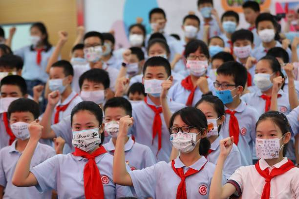 CHN: Primary School Student Attend Graduation Ceremony In Nanjing