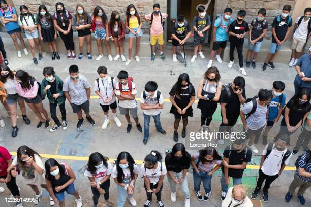 Students wear masks and wait outside during the first day of school at Vedruna Angels School in Raval neighborhood on September 14, 2020 in...