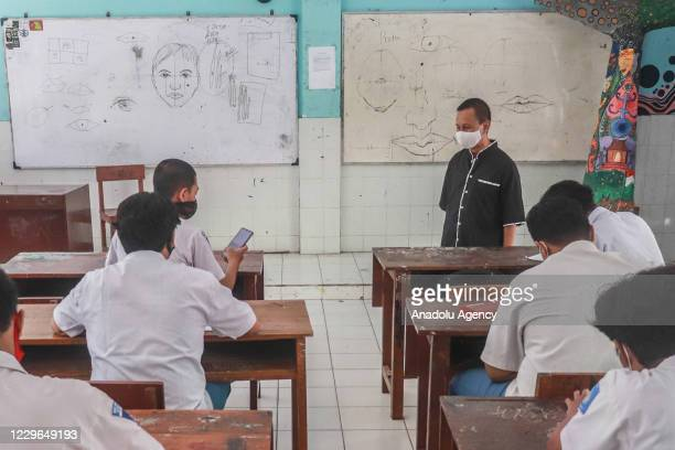 Students wear masks to prevent the spread of coronavirus and physical distancing during learning sessions at a Vocational High School in Surabaya,...