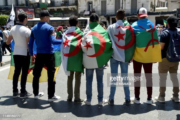 Students wear their national flag as they demonstrate in Algiers on June 11 two days after a vote planned for July 4 was cancelled A vote planned for...