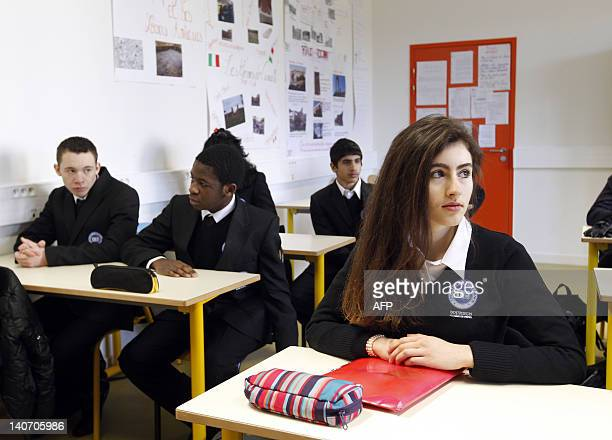 Students wearing black business suits are seen in a classroom of the Excellence Sourdun boarding school on March 5 2012 in Sourdun eastern Paris...