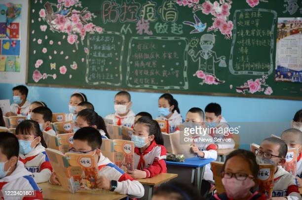 Students wearing face masks have a class at a primary school on May 7 2020 in Huhhot Inner Mongolia Autonomous Region of China A part of primary...