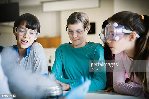 Students wearing protective glasses in classroom