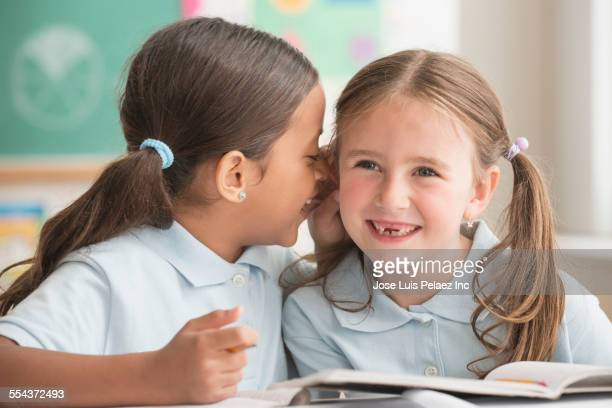 Students whispering in classroom