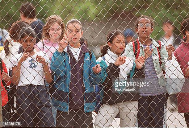 Students who attend St. Paschal Baylon School in North York hang -- literally -- on the fence outside the school prior to the morning bell. Students...