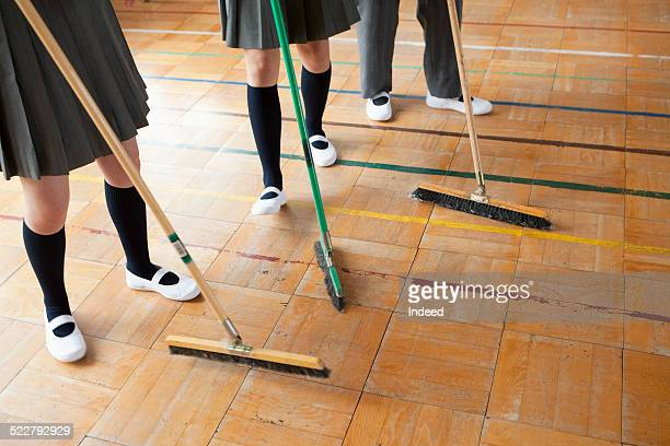3 students who clean in the classroom