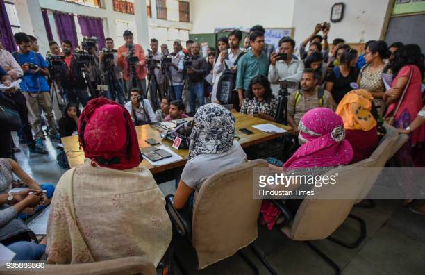 Students who had levelled allegations of sexual harassment by professor Atul Johri speak before media at JNU campus on March 21 2018 in New Delhi...