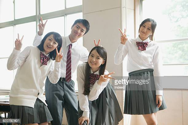 4 students who make a pose
