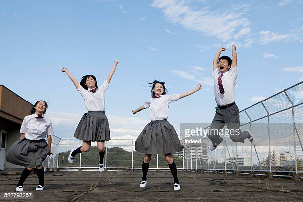 4 students who make a pose