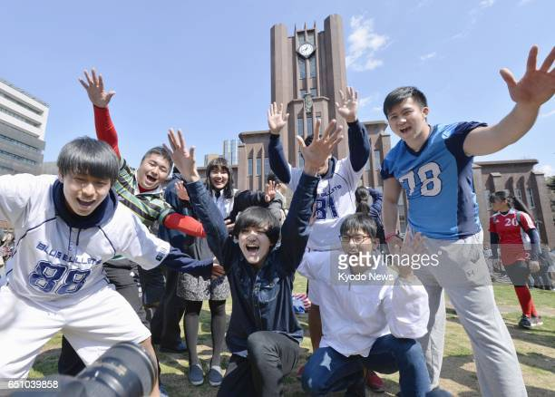 Students who passed the University of Tokyo's entrance exam celebrate at its Hongo campus in Tokyo on March 10 2017 ==Kyodo