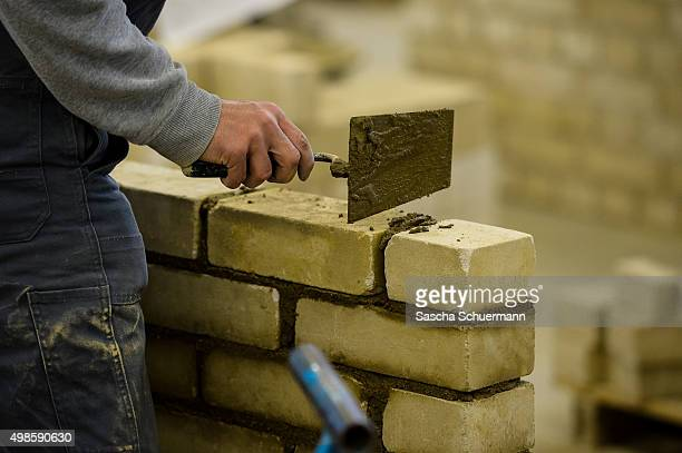 Students with an immigrant background working as a bricklayer at the Vocational training center of the Chamber of Crafts on November 24 2015 in...