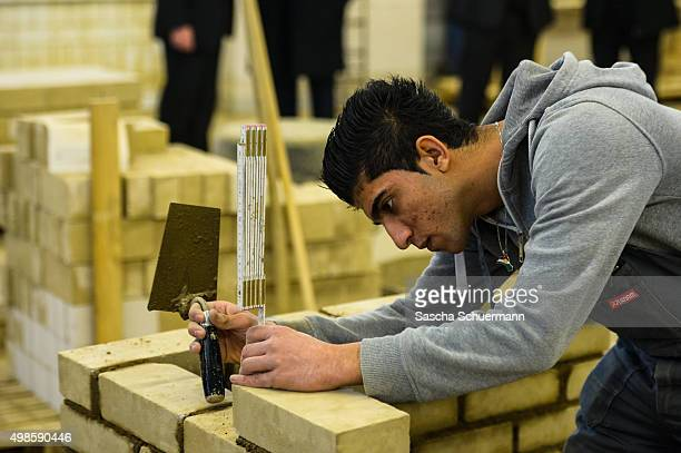 Students with an immigrant background works as a bricklayer at the Vocational training center of the Chamber of Crafts on November 24 2015 in Cologne...