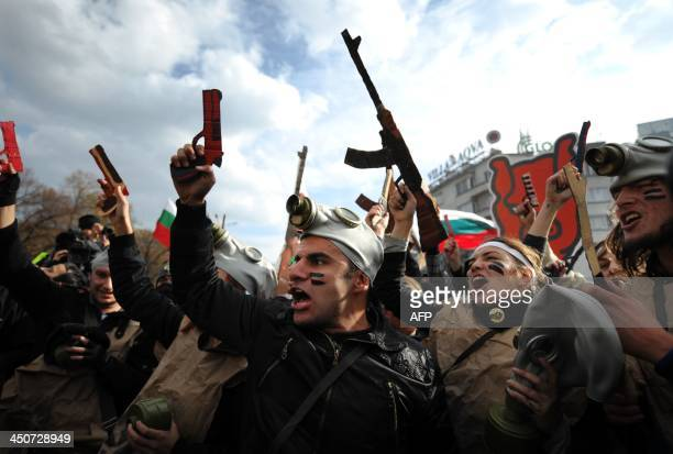 Students with cardboard weapons participate in a performance during an antigovernment protest in front of Bulgarian parliament in Sofia on November...