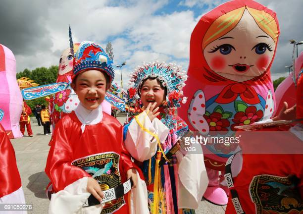Students with parents and teachers from 14 Chinese schools and 2 Russian schools parade during a carnival to welcome the upcoming International...