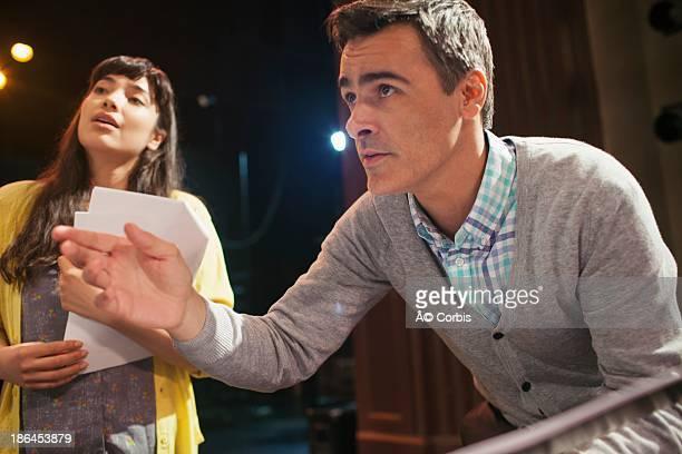 students with teacher preparing performance - actor stock-fotos und bilder