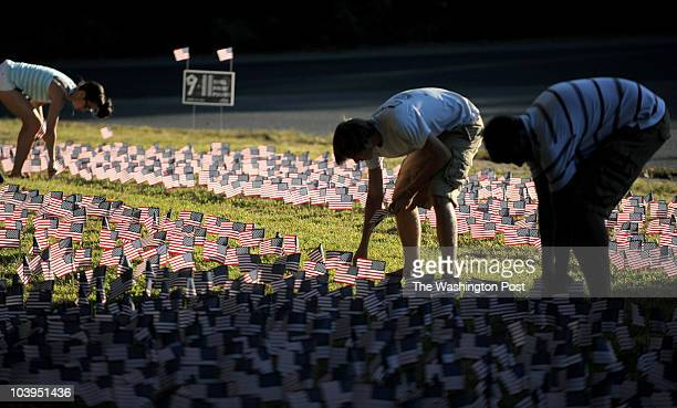 Students with the Young Republicans Club plant American flags into the ground outside Langley High School on September 9 2010 in McLean Va The...
