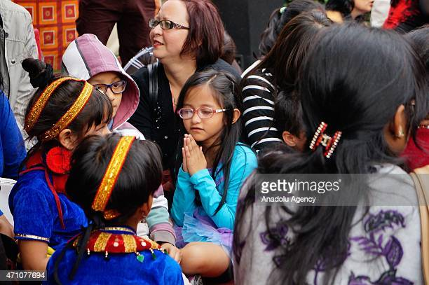 Students with their parents sit at the school ground after 79 magnitude earthquake struck in Kathmandu April 25 2015 Hundreds of people have been...