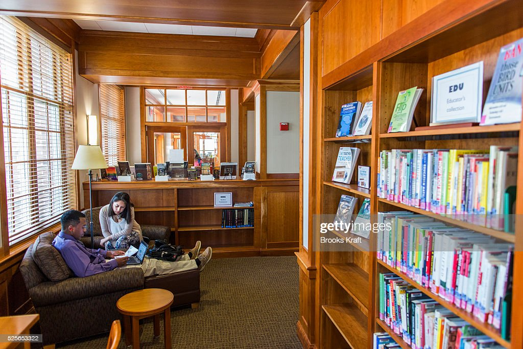 Students work inside a library at Episcopal High School, a ...