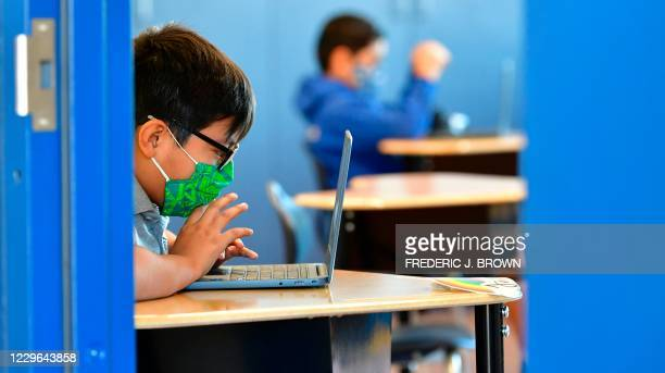 Students work on their laptop computers at St. Joseph Catholic School in La Puente, California on November 16 where pre-kindergarten to Second Grade...