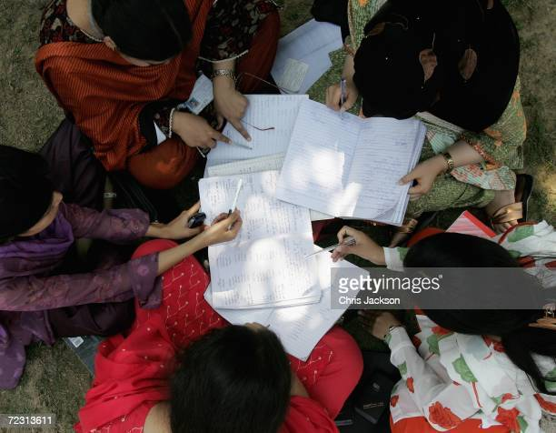 Students work outside at Fatima Jinnah Womens University on the third day of the Royal Tour of Pakistan on October 31 2006 in Islamabad Pakistan...