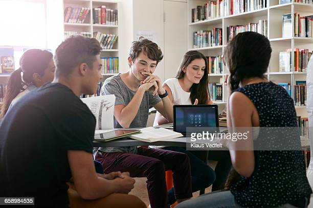 Students working in groups in library